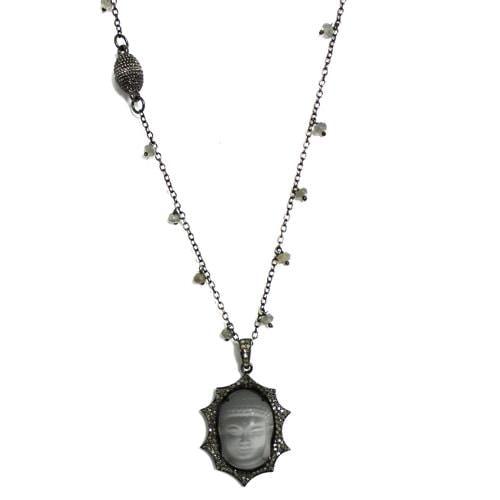 Diamonds surrounding Moonstone Buddha