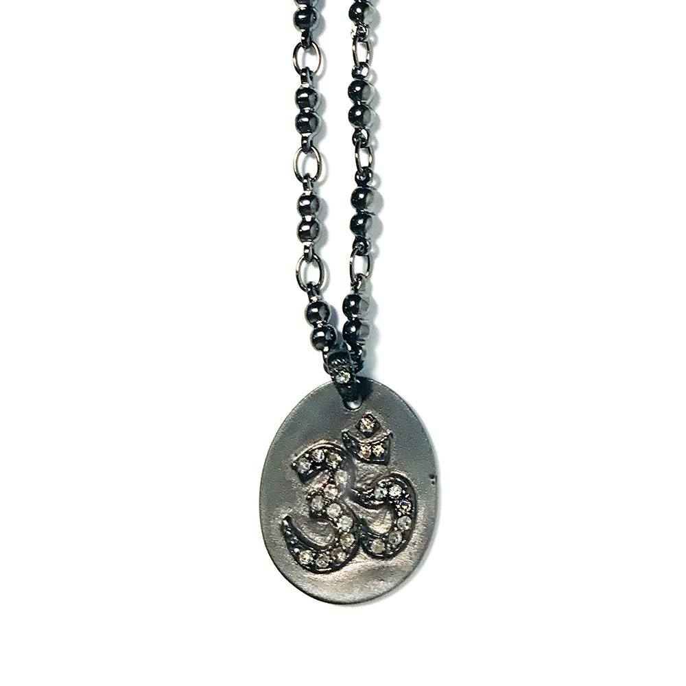 Spinel Om on Matte Silver Disc Pendant Necklace closeup